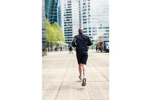 African Man Jogging In Urban Setting