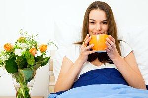 Beautiful Woman Having Coffee In Bed