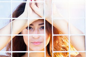 Young woman behind the metal mesh