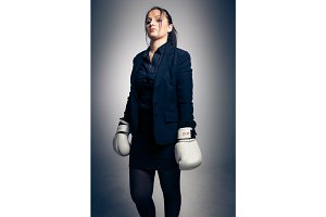 Boxing Businesswoman in Studio