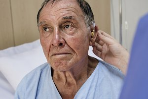 Old man wearing hearing aids