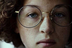 Young Caucasian girl with eyeglasses