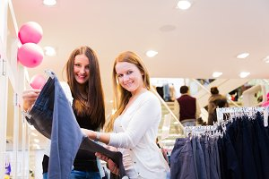 Friends Shopping For Clothes