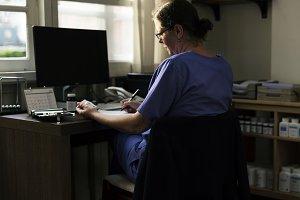 A doctor checking medicine stock