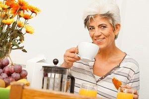Happy Mature Lady Having Breakfast