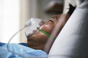 A sick Asian man in a hospital