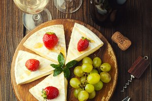 Cheese with strawberries