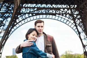 Multi-ethnic Couple Having Fun In Paris Near Eiffel Tower