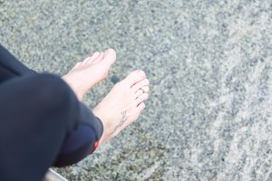 Woman's Feet By The Water