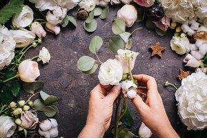 Florist makes a bouquet