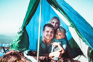 The family looks out of the tent