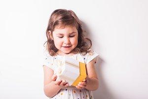Girl open a giftbox