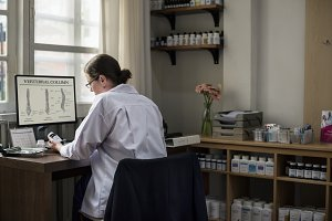 A doctor writing a prescription