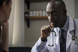 African descent doctor examining
