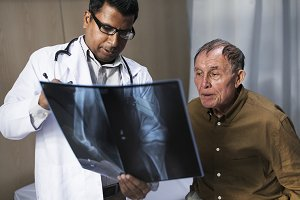 Doctor with a patient's x-ray film