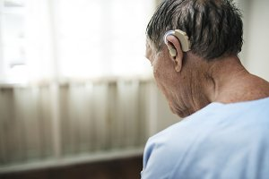 Elderly man wearing hearing aids