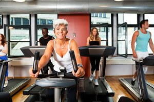 Young People And Mature Lady At The Gym