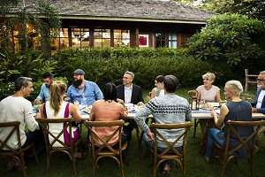 Group of diverse friends have dinner