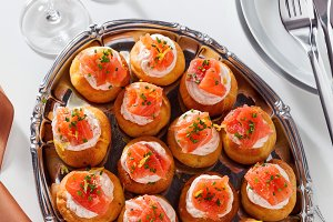 Salmon and creamcheese puffs . Pastries  and champagne. holiday