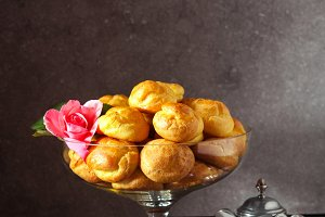 profiteroles and coffee Served in a vase for sweets and a rose