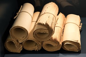 Rolls of old yellowed books and papers