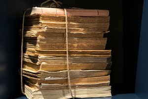 Stack of old yellowed books and papers