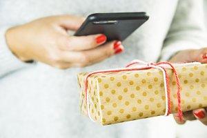 a modern girl uses the Internet through a smartphone