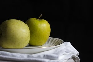 Two apples with black background