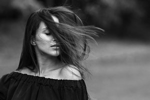 Girl portrait black and white hair wind