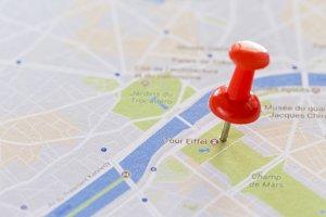 Pushpins marking cities