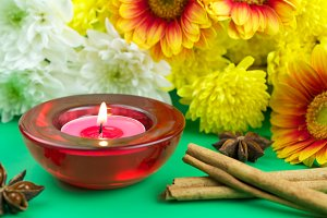 Candle, flowers and spice