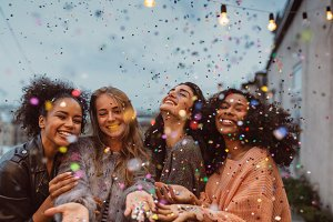 Beautiful women under confetti