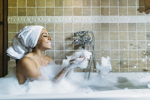 happy young woman  in bathtub