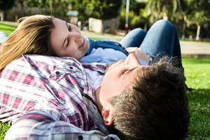 Couple lying on the grass in a park