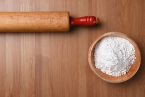 Rolling pin and bowl of flour
