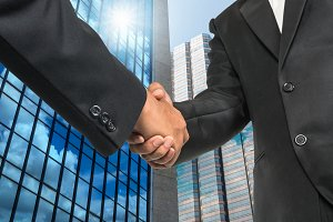 Hand shake between businessman
