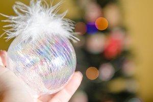 Christmas ball on woman hand