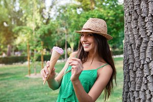 Young beautiful woman eating an ice cream