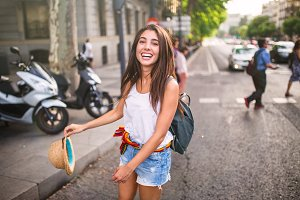 young cheerful woman in the street