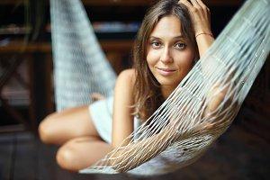 beautiful woman lying in hammock