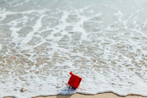 present gift in red box on the beach