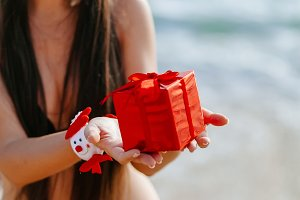 santa girl in bikini on the beach
