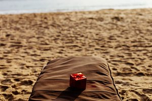 present in red box on the beach