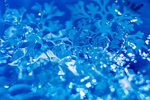 snowflake melts in water macro