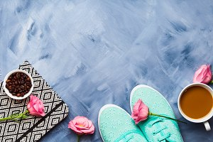 Flat lay with shoes, coffee and flowers