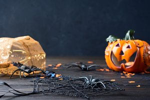 Black background with Halloween holiday symbols