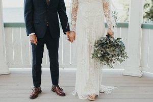 Boho Wedding Couple Holding Hands