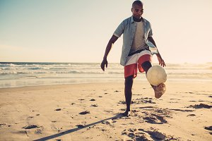 African man playing with soccer ball