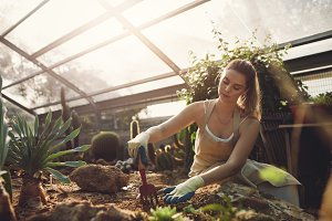 Female worker gardening