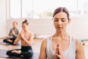 Healthy woman doing meditating